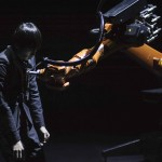 NEW YORK, NY - February 10, 2015 - Huang Yi rehearses with robot 'Kuka' at 3-Legged Dog.
